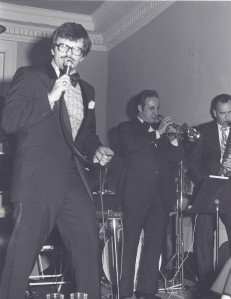 Monty on stage backed by Lucian Montagna on trumpet