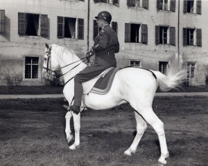 "August 1945. Gen. Patton riding ""Favory Africa"", which Hitler had personally picked out to be presented to Emperor Hirohito.  The horse formerly belonged to the riding school of Vienna.  It was confiscated by the Germans and later returned by the Americans. US Army Photo"