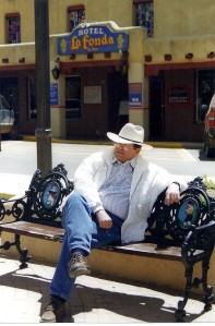 Monty waits for a chance encounter on the plaza in Taos, New Mexico